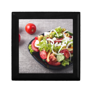 Small bowl of salad made from natural vegetables small square gift box