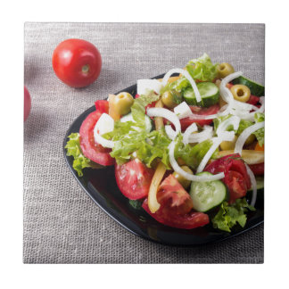 Small bowl of salad made from natural vegetables small square tile
