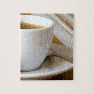 Small cup of espresso on a saucer with sugar jigsaw puzzle
