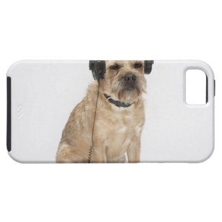 Small dog wearing headphones case for the iPhone 5