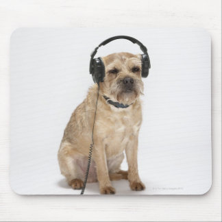 Small dog wearing headphones mouse pad
