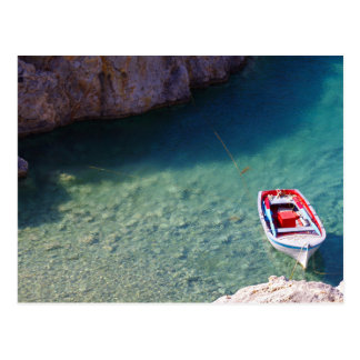 small floating  boat on the crystal clear cliff la postcard