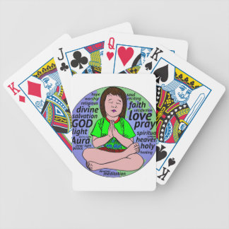 Small girl praying and meditating,sitting on earth bicycle playing cards