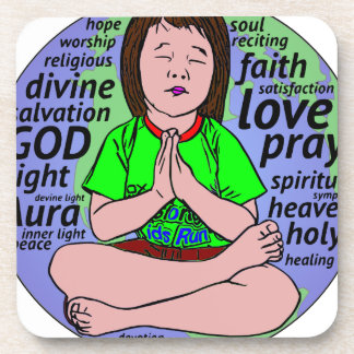 Small girl praying and meditating,sitting on earth coaster