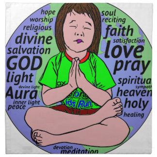 Small girl praying and meditating,sitting on earth napkin