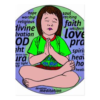 Small girl praying and meditating,sitting on earth postcard