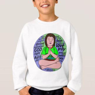 Small girl praying and meditating,sitting on earth sweatshirt