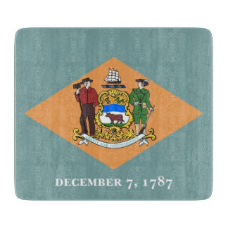 Small glass cutting board with flag of Delaware