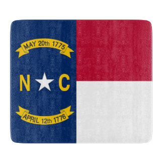 Small glass cutting board with North Carolina flag