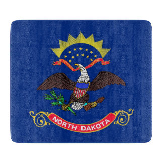 Small glass cutting board with North Dakota flag