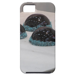 Small glazed chocolate cakes with hazelnut grains case for the iPhone 5