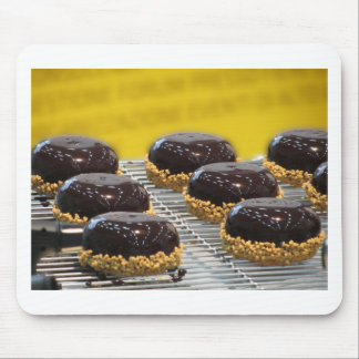 Small glazed chocolate cakes with hazelnut grains mouse pad
