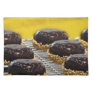Small glazed chocolate cakes with hazelnut grains placemat