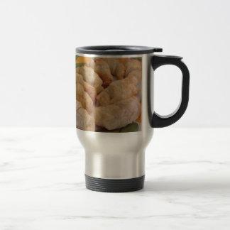 Small homemade salty croissants stuffed travel mug