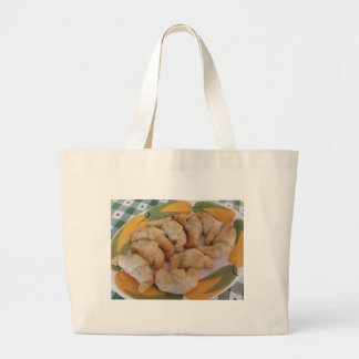 Small homemade salty croissants with sausage large tote bag