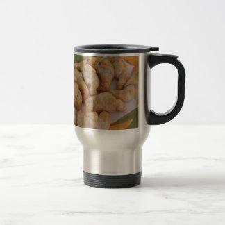 Small homemade salty croissants with sausage travel mug