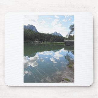 Small mountain lake with reflections of clouds mouse pad