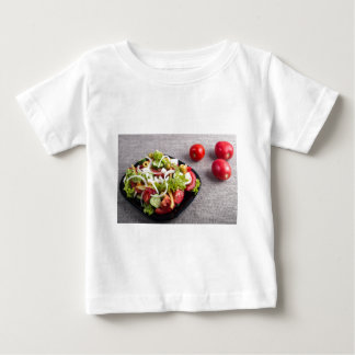 Small plate of natural salad of raw vegetables baby T-Shirt