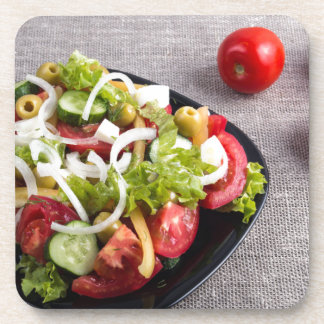 Small plate of natural salad of raw vegetables beverage coasters