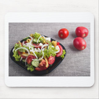 Small plate of natural salad of raw vegetables mouse pad