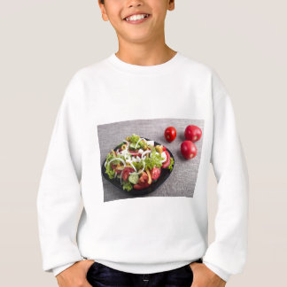 Small plate of natural salad of raw vegetables sweatshirt