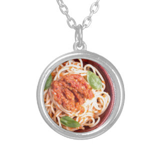 Small portion of cooked spaghetti with tomato silver plated necklace