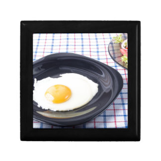 Small portion of the breakfast of fried egg small square gift box