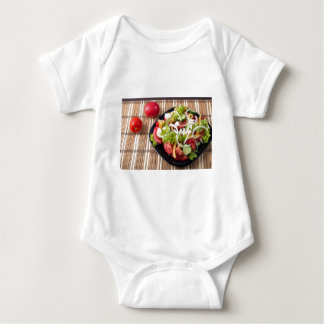 Small portion of vegetable salad of tomato baby bodysuit