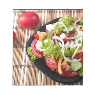 Small portion of vegetable salad of tomato notepad