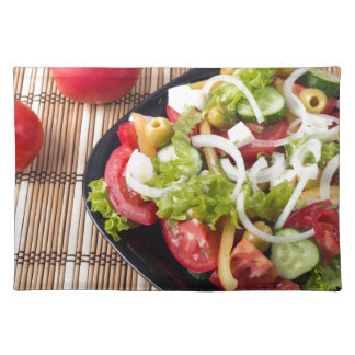 Small portion of vegetable salad of tomato place mats
