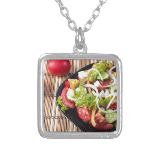 Small portion of vegetable salad of tomato silver plated necklace