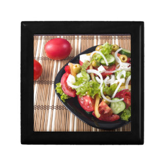 Small portion of vegetable salad of tomato small square gift box
