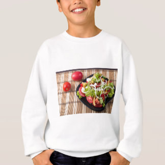 Small portion of vegetable salad of tomato sweatshirt