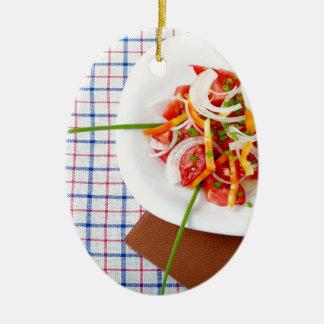 small portion of vegetarian salad ceramic oval decoration