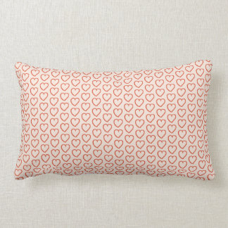 Small red hearts on pastel pink lumbar pillow