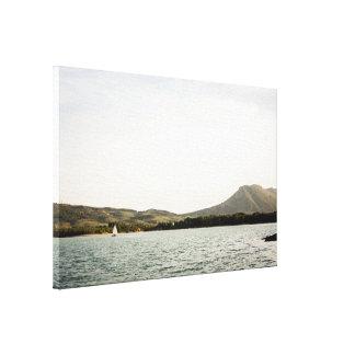Small ship sailing on a lake at the afternoon canvas print