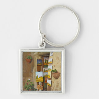 Small shope with artwork for sale on sidewalk Silver-Colored square key ring