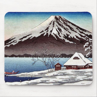 Small snow covered building on the coast mousepads