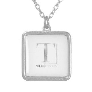 Small sterling silver Trae London logo pendant