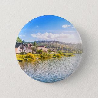 Small village near a lake 6 cm round badge