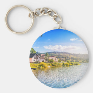 Small village near a lake key ring