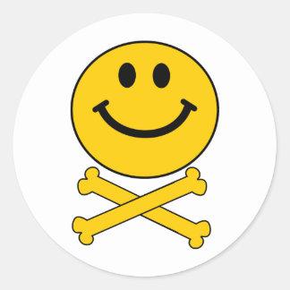 Smiley skull and crossbones round sticker