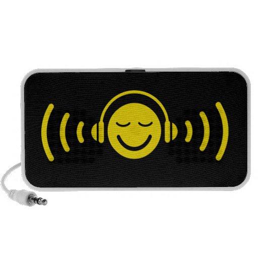 Smiley with headphones listening on music speakers