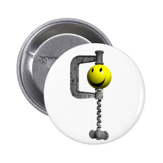 Smiley yellow head caught in a vice 6 cm round badge