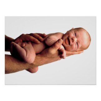 Smiling baby on hand poster