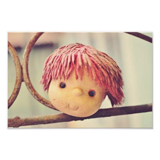 Smiling doll head photo art