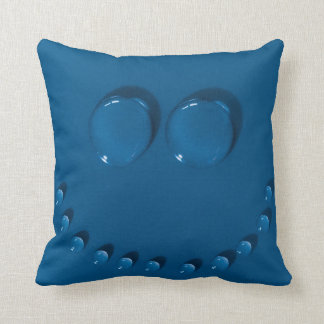 Smiling face made of waterdrops on a blue cushion