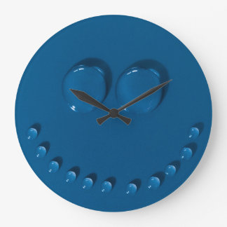 Smiling face made of waterdrops on a blue large clock