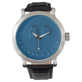 Smiling face made of waterdrops on a blue wristwatches