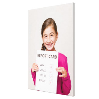Smiling girl student proud of report card canvas prints
